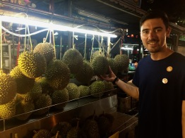 Lewis buying a durian.
